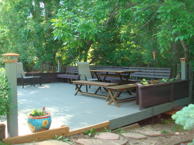 timbertech silver maple deck, redwood bench/ planters stained, solar post caps